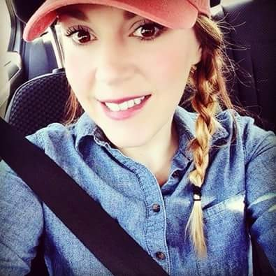 Girl wearing red hat in car