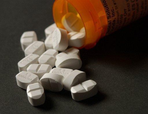 Pills spilling out of pill bottle