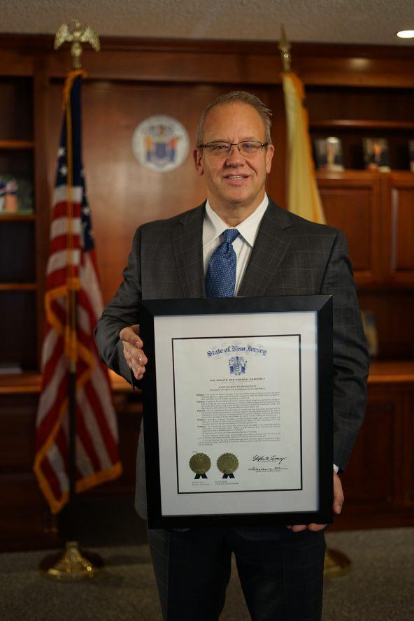 Michael DeLeon accepting award