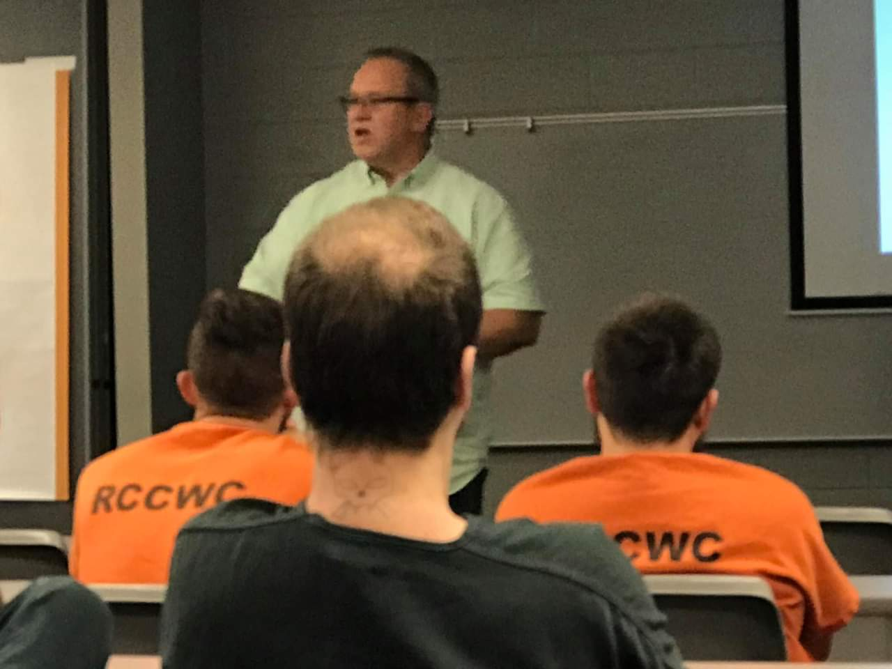 Michael in classroom with inmates