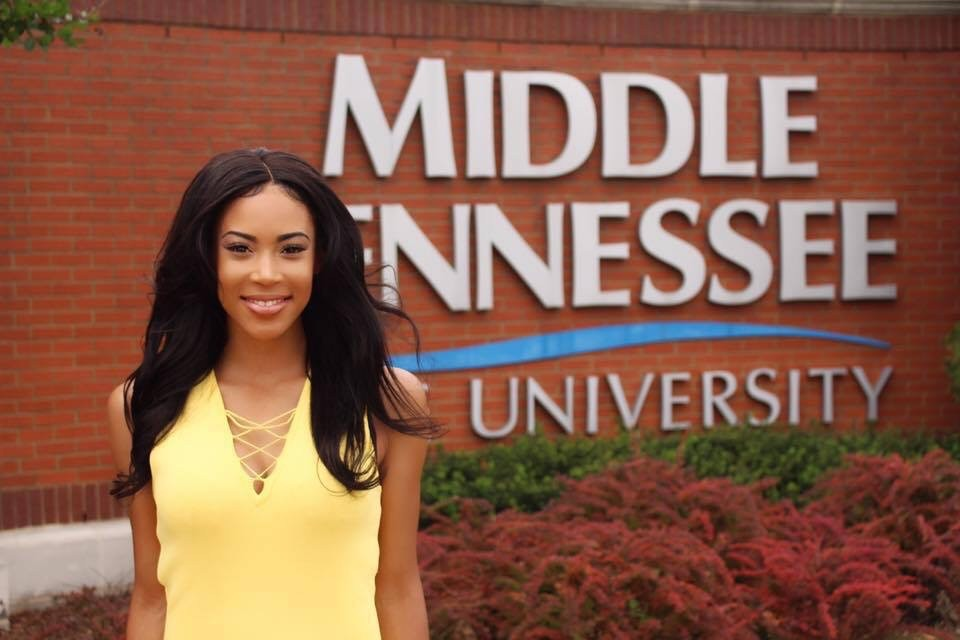 Shaina Marie Afful in front of Middle Tennessee University signage