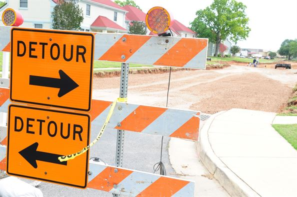 Orange signs saying detour - both pointing in opposite directions